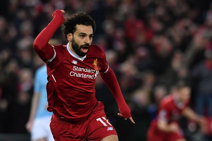 Salah celebrates scoring the opening goal in Liverpool's 3-0 Champions League quarter-final win against Manchester City.