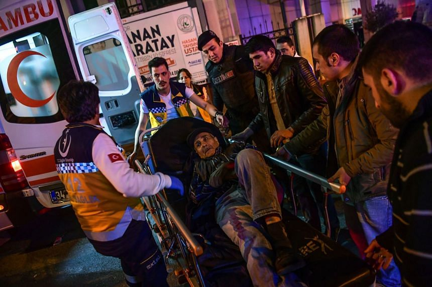 People are evacuated by emergency workers after a fire broke out at an Istanbul hospital.
