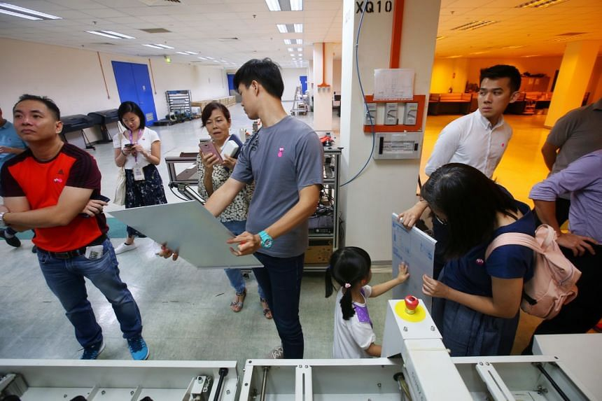 50 readers went on a tour of Singapore Press Holdings Print Centre in Jurong Port Road on April 6, 2018.
