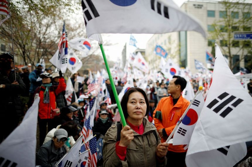 Members of a conservative civic group attend a protest to support ousted President Park Geun hye outside a court in Seoul, on April 6, 2018.