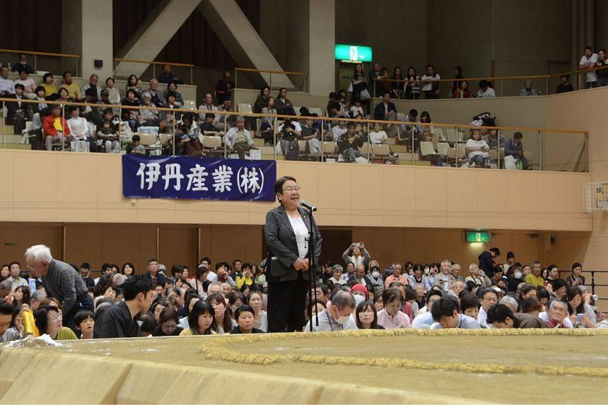 Ms Tomoko Nakagawa, mayor of the Japanese city of Takarazuka, delivering a speech outside a sumo ring in Takarazuka on April 6, 2018.
