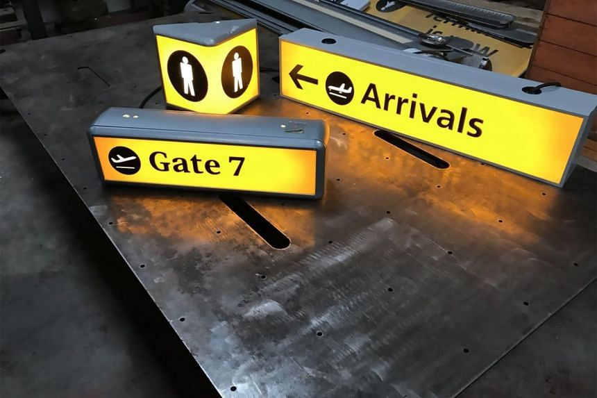 Signage from the closed Terminal 1 building at Heathrow Airport in London. The contents of the airport terminal will be auctioned off this month, sale organisers said on April 6, 2018.