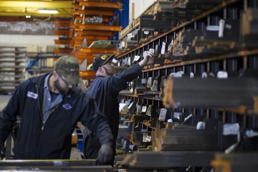Laborers fill orders of machine grade steel to be shipped throughout the Pacific Northwest at the Pacific Machinery & Tool Steel Company on March 6, 2018 in Portland, Oregon.