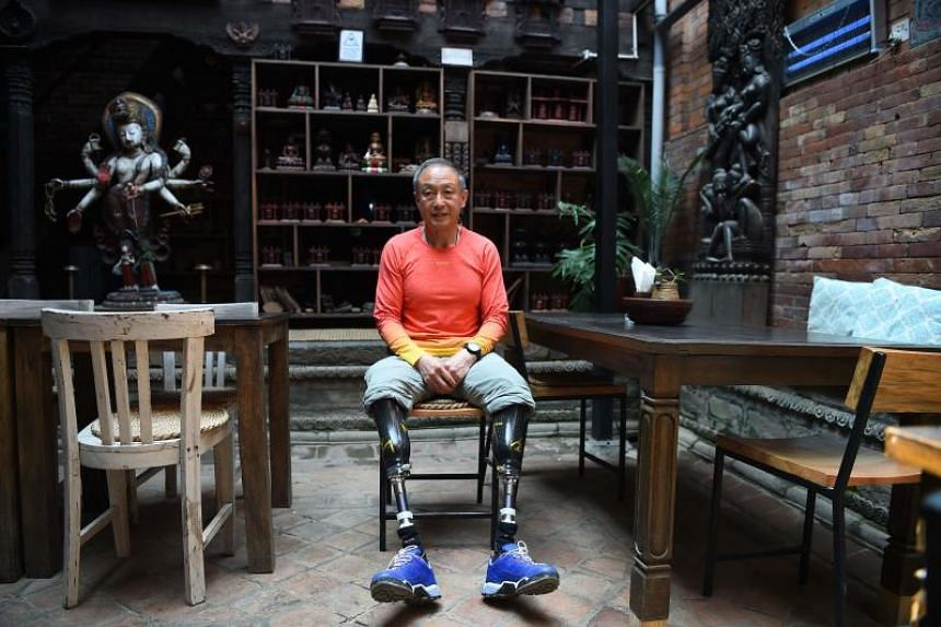 "Chinese double amputee climber Xia Boyu said the ban on blind and double amputee climbers was ""discriminating against the disabled""."