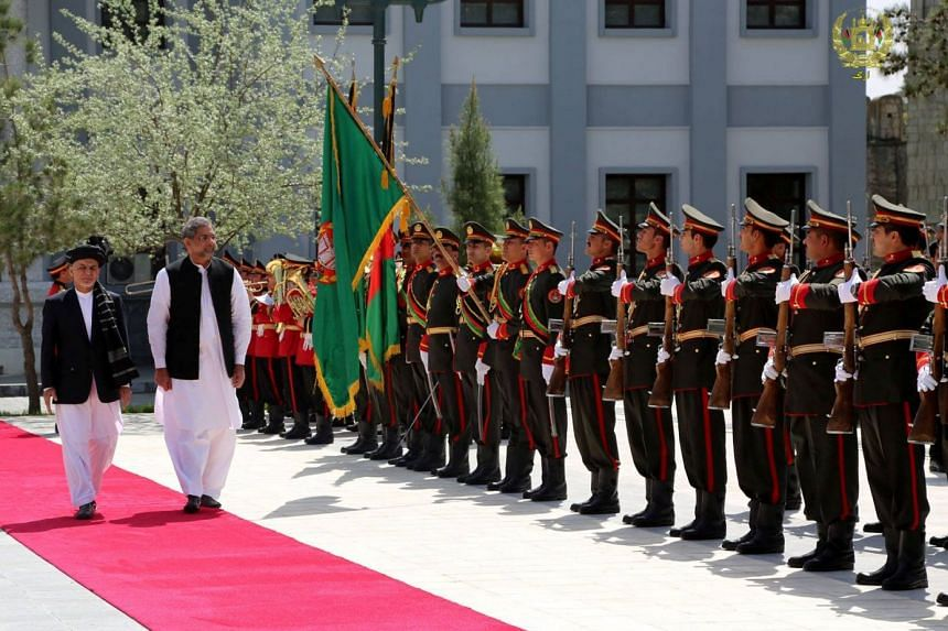 Afghanistan's Ashraf Ghani and Pakistan's Shahid Khaqan Abbasi inspect the honour guard in Kabul.