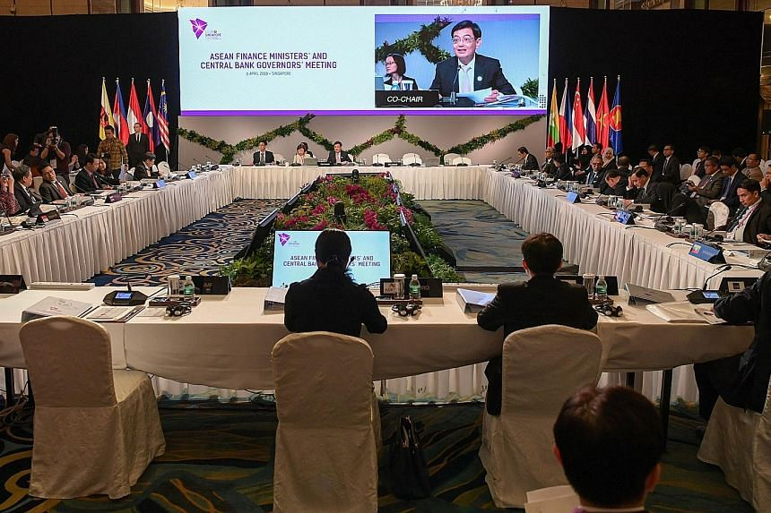 Mr Heng at yesterday's meeting of Asean finance ministers and central bank governors.