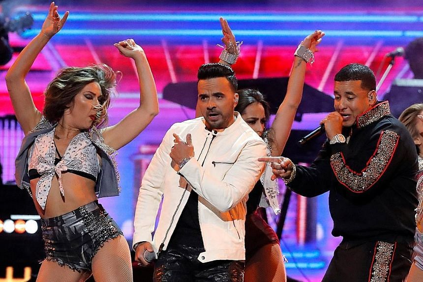 Luis Fonsi (left) and Daddy Yankee performing Despacito at the 60th Annual Grammy Awards show in January.