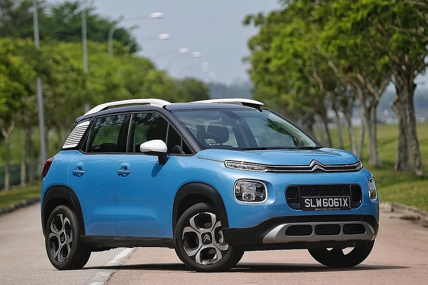 The Citroen C3 Aircross (left) has a large boot (far left) - the rear seats can slide forward, allowing for as much as 410 litres of stowage without folding any seats.