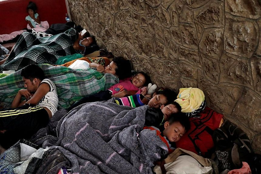 Children, part of a caravan of Latin American migrants moving through Mexico towards the US border, sleeping at a sports centre in Matias Romero on Thursday. The caravan aims to raise awareness about the plight of migrants, and has been running annua