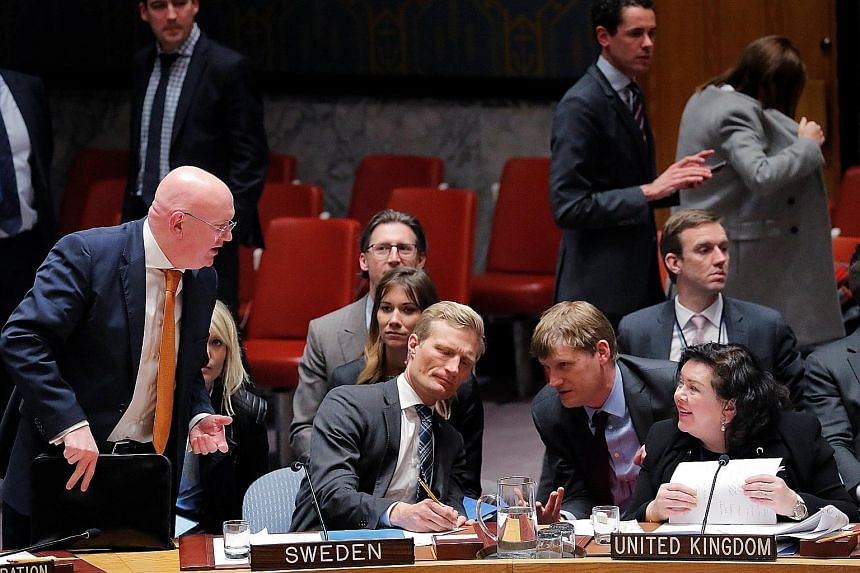 Russian Ambassador Vassily Nebenzia (left) speaking with British Ambassador Karen Pierce (right) at a UN Security Council meeting on Thursday. Moscow called for the talks after failing to win backing for a joint probe of the poisoning at an Organisat