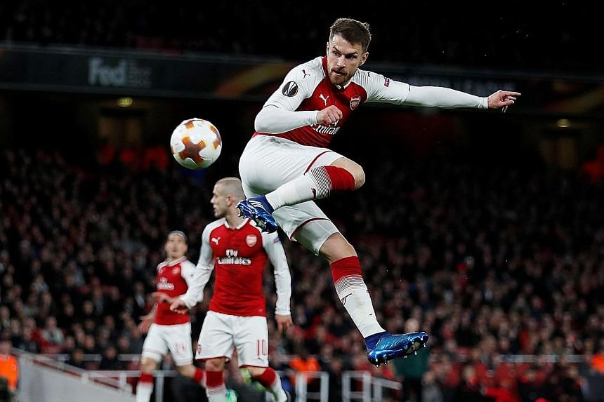 Arsenal's Aaron Ramsey scoring the Gunners' third goal against CSKA Moscow in their 4-1 Europa League quarter-final, first-leg victory.