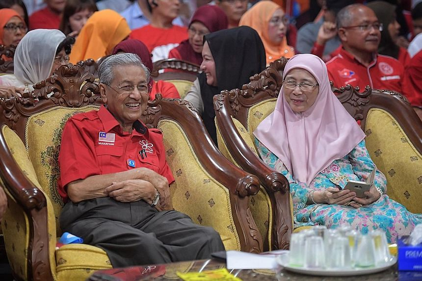 Former Malaysian prime minister Mahathir Mohamad and PKR president Wan Azizah Wan Ismail at the rally in Johor yesterday.