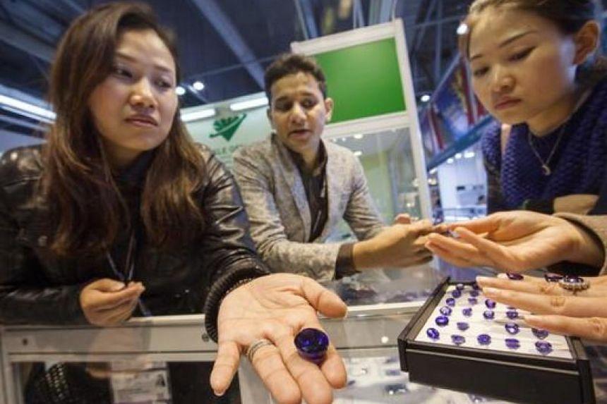 People look at Tanzanite at the Hong Kong International Diamond, Gem and Pearl Show, Hong Kong, China, on March 1, 2016.