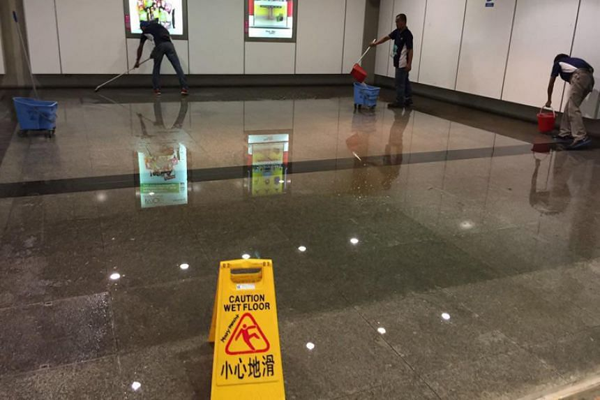 Workers clearing away water at Marymount MRT station at 6pm on April 7, 2018.