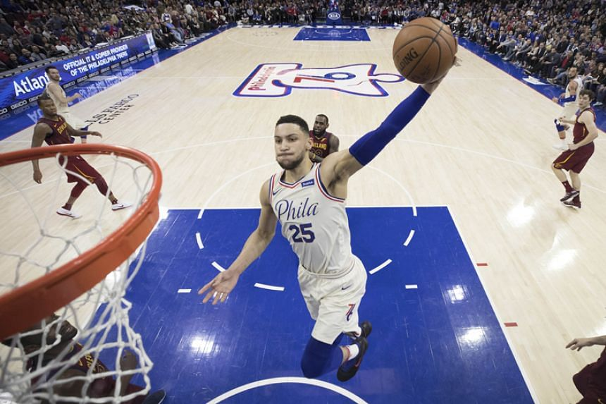 Ben Simmons of the Philadelphia 76ers dunks the ball in the second quarter of the NBA game against Cleveland Cavaliers at the Wells Fargo Center in Philadelphia on April 6, 2018.