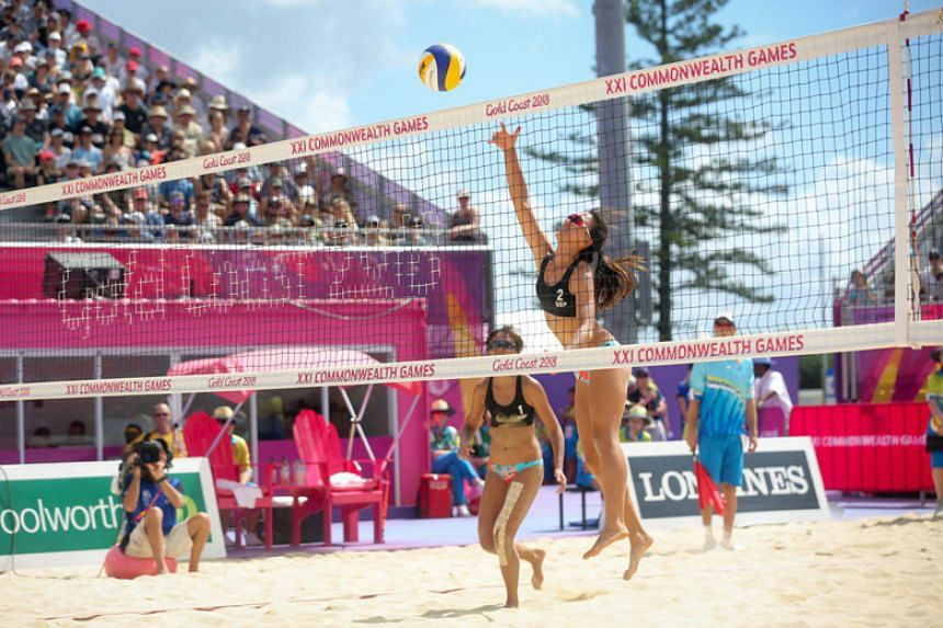 Singapore's beach volleyball pair Lau Ee Shan (left) and Ong Wei Yu (right) lost 9-21, 12-21 in their Pool C opener against Vanuatu at the Commonwealth Games on April 7, 2018.