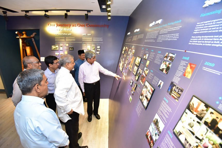 Minister-in-charge of Muslim Affairs Yaacob Ibrahim with members of the Islamic Religious Council of Singapore's senior management viewing a new gallery at the Singapore Islamic Hub on April 7, 2018.