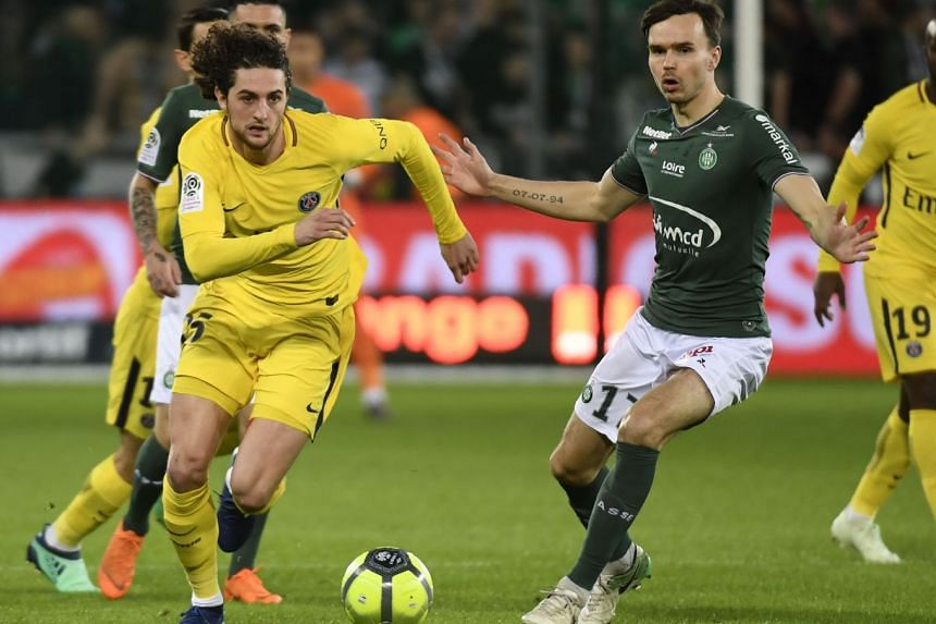 Paris Saint-Germain's French midfielder Adrien Rabiot (left) fights for the ball with Saint-Etienne's Norwegian midfielder Ole Selnaes (right), on April 6, 2018.