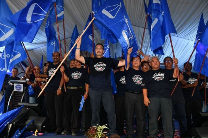 Datuk Seri Hishammuddin Hussein (centre) with some of his supporters during the launch of the Sembrong Barisan Nasional election machinery on April 6.