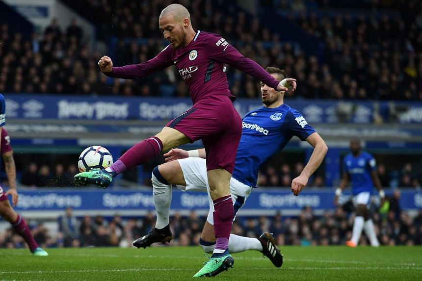 Manchester City's Spanish midfielder David Silva crosses the ball during the English Premier League football match between Everton and Manchester City at Goodison Park, on March 31, 2018.