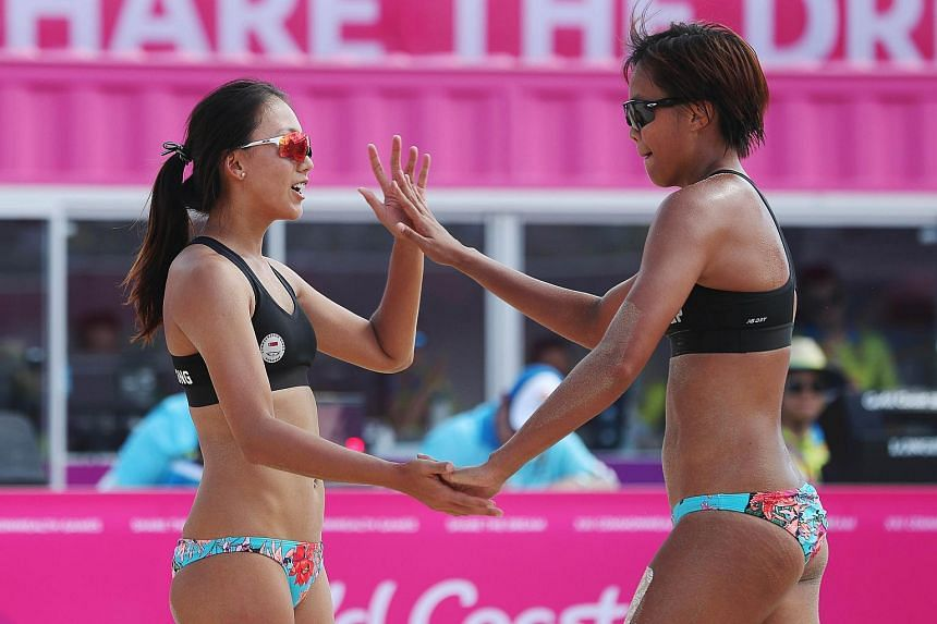 Singapore's beach volleyball pair Ong Wei Yu (left) and Lau Ee Shan (right) lost 9-21, 12-21 in their Pool C opener against Vanuatu at the Commonwealth Games on April 7, 2018.