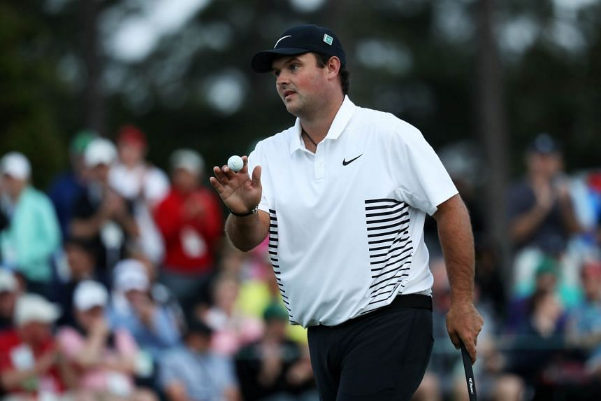 Patrick Reed of the United States waves on the 18th green during the second round of the Masters tournament at Augusta National Golf Club in Augusta, Georgia, on April 6, 2018.