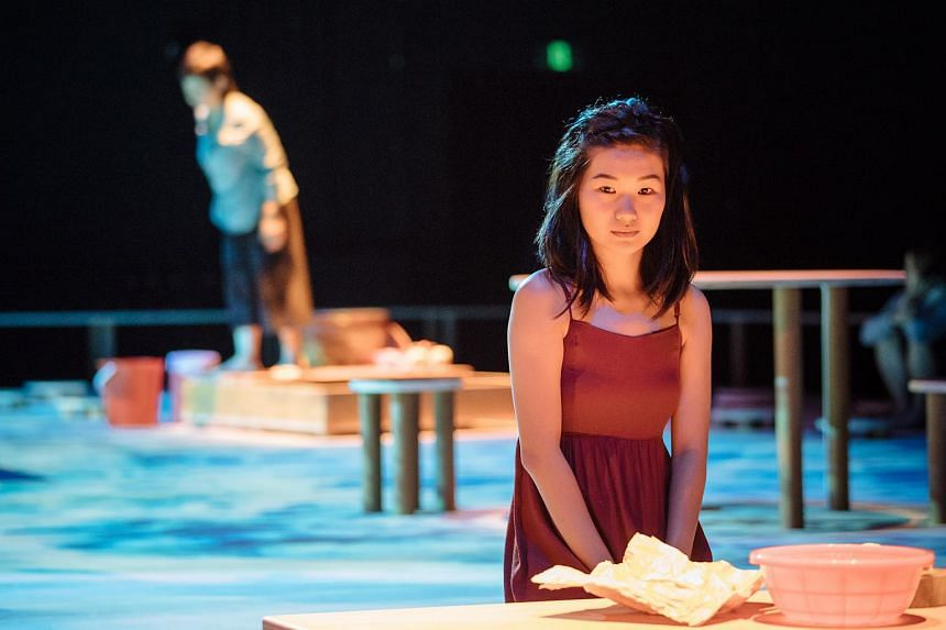 Actresses Tan Hui Er (in foreground) and Jalyn Han (in background) in the theatre production In The Silence Of Your Heart.