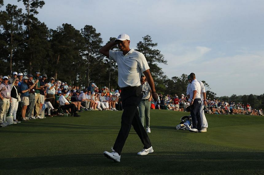 Tiger Woods walks off the 18th green after finishing second round play of the Masters tournament at the Augusta National Golf Club in Augusta, Georgia, on April 6, 2018.