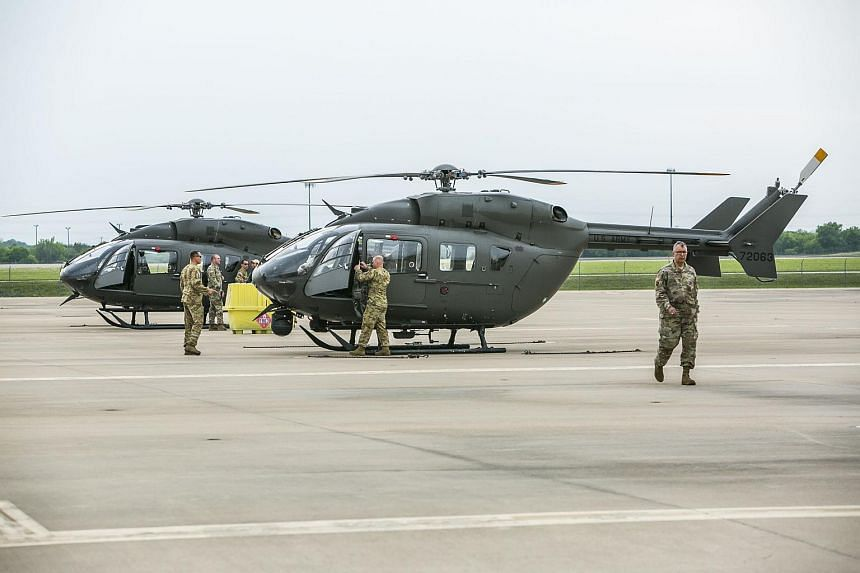 Texas National Guard helicopters travelling to the Texas-Mexico border prepare to fly on April 6, 2018, in Austin, Texas.