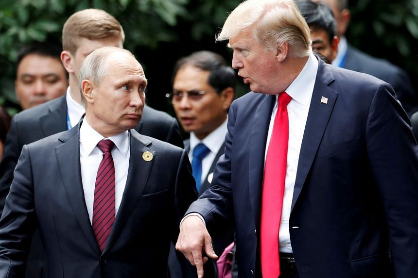Russian President Vladimir Putin with US President Donald Trump at the Apec summit last November in Danang, Vietnam. The sanctions are likely to complicate Mr Trump's hopes for good ties with Mr Putin.