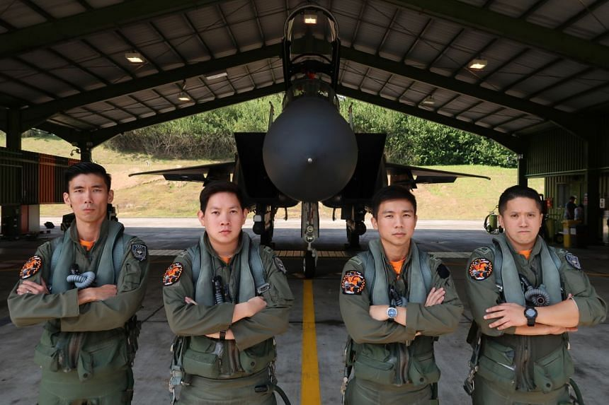 The RSAF crew who suited up and took off in two F-15SG fighter jets on Thursday. (From left) Captain Chong Qiu Wei, weapon systems officer (fighter), 31; Captain Loy Shi Bin, pilot, 28; Captain James Chai Wang Cong, pilot, 29; and Major Peter Liow Ti