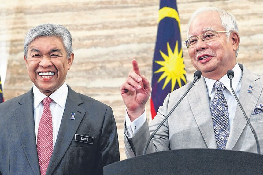 Prime Minister Najib Razak, with deputy Ahmad Zahid Hamidi, announcing the dissolution of Parliament.