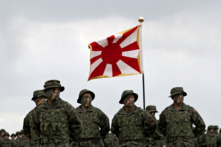 Soldiers of Japanese Ground Self-Defense Force's Amphibious Rapid Deployment Brigade, Japan's first marine unit since World War Two, gather at a ceremony activating the brigade at Camp Ainoura in Sasebo, Japan, on April 7, 2018.