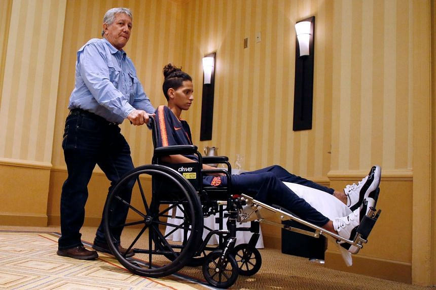 Marjory Stoneman Douglas High School shooting victim Anthony Borges is wheeled out of a press conference by his grandfather Alfredo Borges in Plantation, Florida, on April 6, 2018.