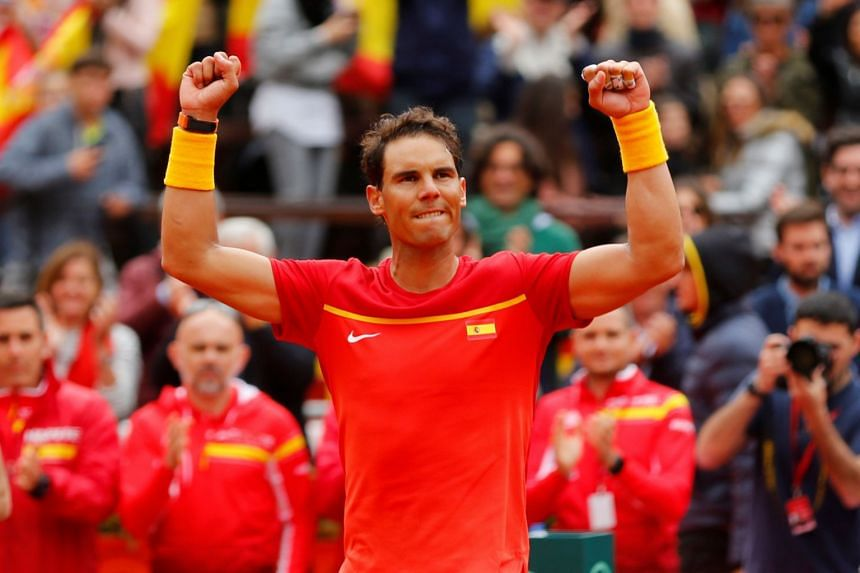 Nadal celebrates winning his quarter final match against Germany's Philipp Kohlschreiber.