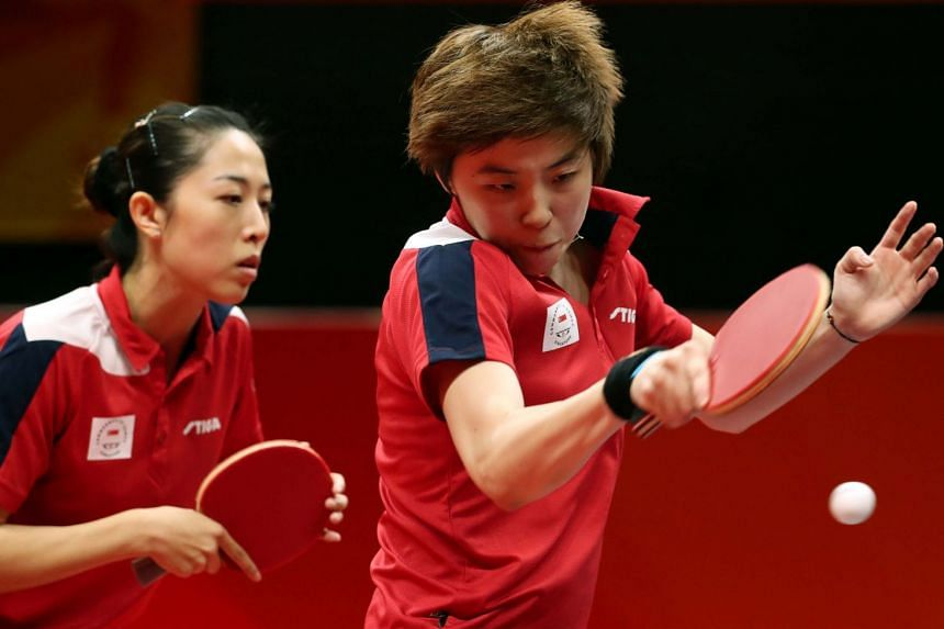 Yu Mengyu and Zhou Yihan of Singapore in their 1-3 loss to Mouma Das and Madhurika Patkar in the doubles match of the women's team final. India shocked Singapore 3-1 to take the gold.