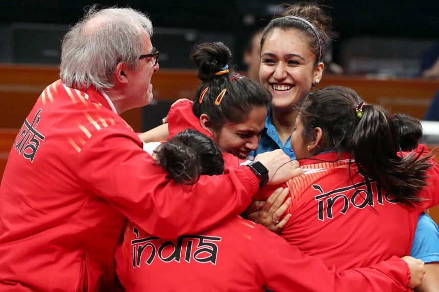 Members of the India team celebrate their gold medal.