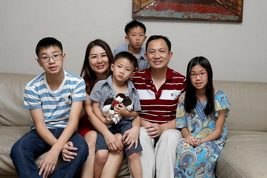 Mr Teyu Che Chern and his wife Jill with their children (from left) Dale, David, Warren and Sofia. The Phillip Futures chief executive joined the firm's parent company PhillipCapital in 1998 as a management trainee in the back office, while the regio