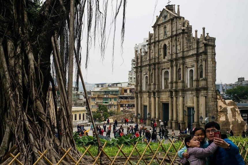 Tourists at the ruins of St Paul's Church, a 17th-century Portuguese complex, in Macau. Chinese citizens' thirst for travel is only just warming up with growing affluence and rising consumer confidence.
