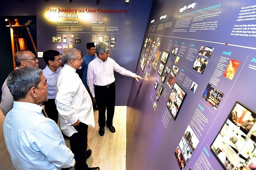 Minister-in-charge of Muslim Affairs Yaacob Ibrahim (far right) with members of Muis' senior management at a new gallery showcasing the history of Muis at the Singapore Islamic Hub yesterday.