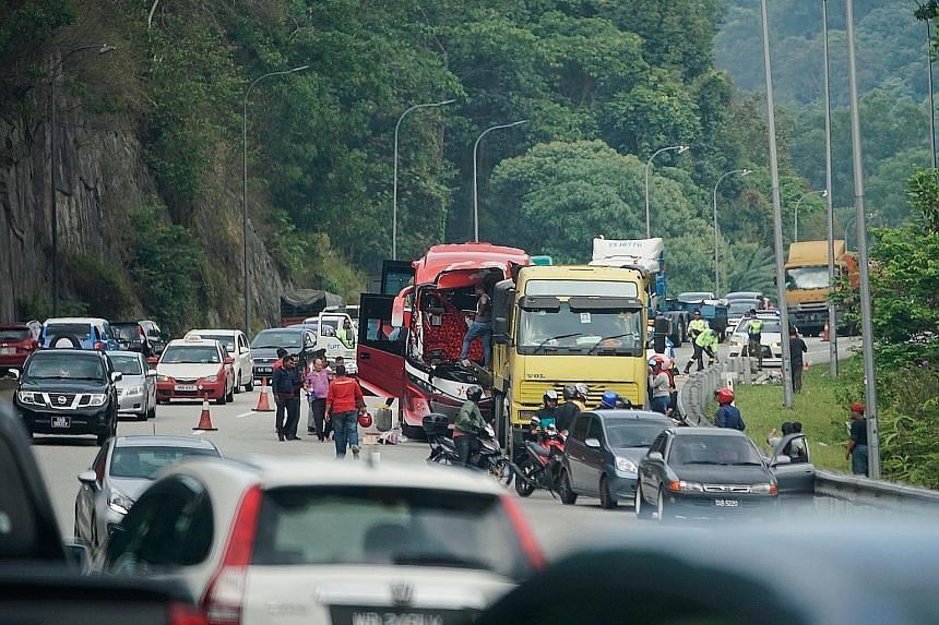 The accident involving a bus and a lorry on the Karak-Kuala Lumpur Expressway yesterday involved 11 Singaporeans and three Malaysians, including the driver and the bus conductor.