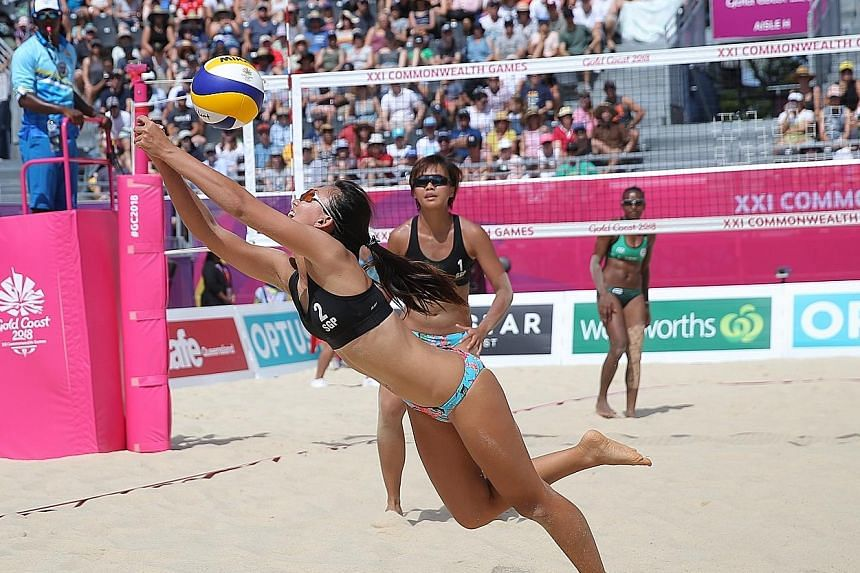 Singapore's Ong Wei Yu scrambling to save a spike as partner Lau Ee Shan looks on during their Pool C opener against the Vanuatuan pair of Miller Pata and Linline Matauatu on the Coolangatta beachfront. Ong and Lau, playing in their first internation