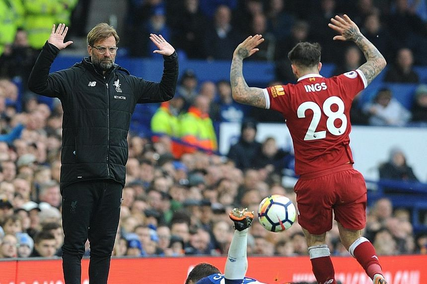 Liverpool manager Jurgen Klopp and Danny Ings reacting in unison after the forward's scuffle with Everton full-back Seamus Coleman. The teams played out a tepid goal-less draw.