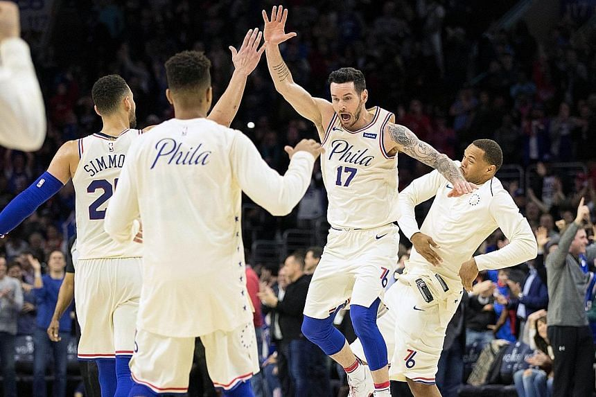 Philadelphia 76ers guard JJ Redick (17) shows his delight after scoring a basket during the 132-130 win against the Cleveland Cavaliers. It was the 13th straight win for the Sixers, who have already clinched their first play-off berth since 2012.