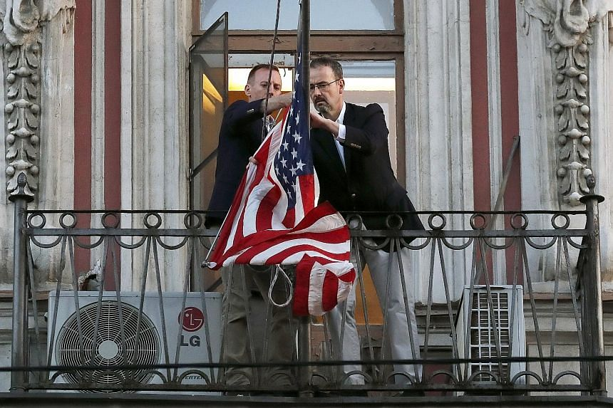 Employees of the US Consulate in St Petersburg removing the US flag last month, after Moscow ordered the closure of the consulate in an ongoing tit for tat over the poisoning of former Russian spy Sergei Skripal in Britain.