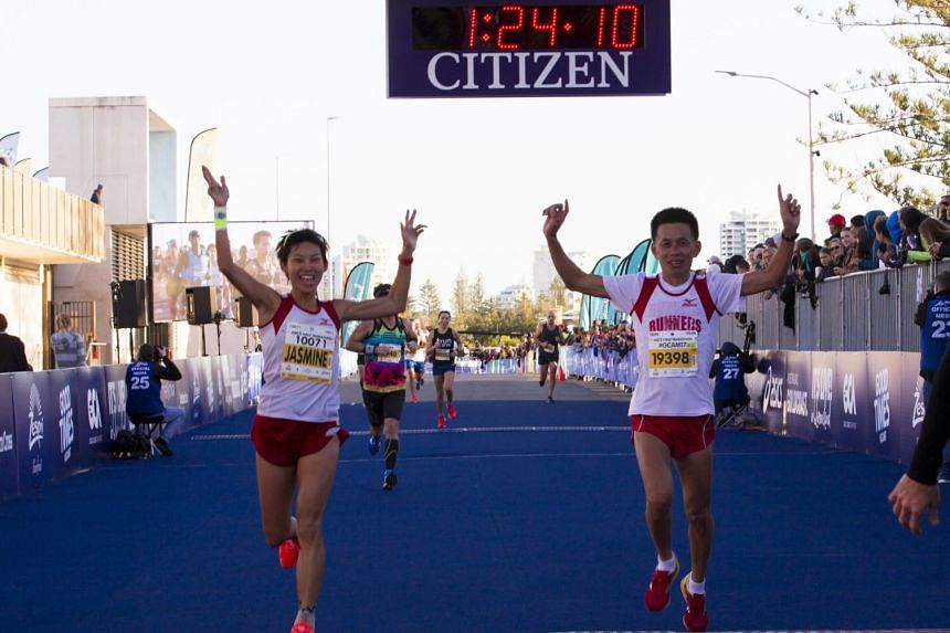 Marathoner Jasmine Goh with coach Lexxus Tan at the finish line of the 21km event in the Gold Coast Marathon on July 2, 2017. She ran a personal best of 1hr 24min 10sec.