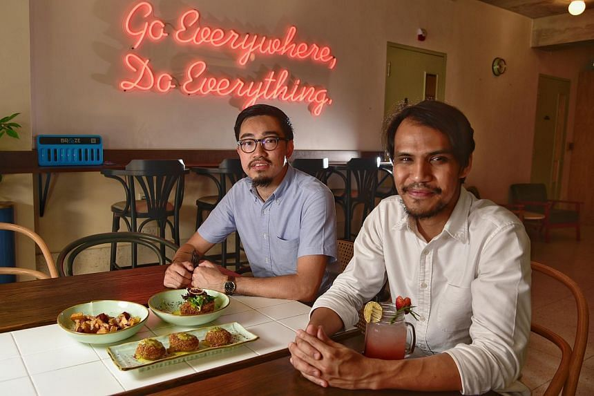 The Black Hole Group founders Calvin Seah (left) and Mustaffa Kamal, at their latest restaurant The Great Mischief.