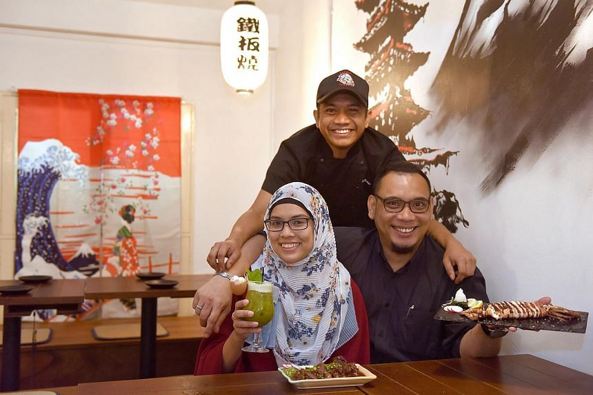 Hararu Izakaya assistant head chef Nur Azhar (standing) with co-owners Wahida Wahid (left) and Diet Hidayat in 2017.
