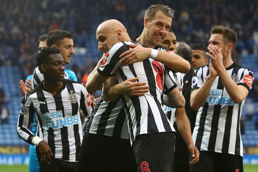 Newcastle's Florian Lejeune (right) embraces Jonjo Shelvey at the end of the match.