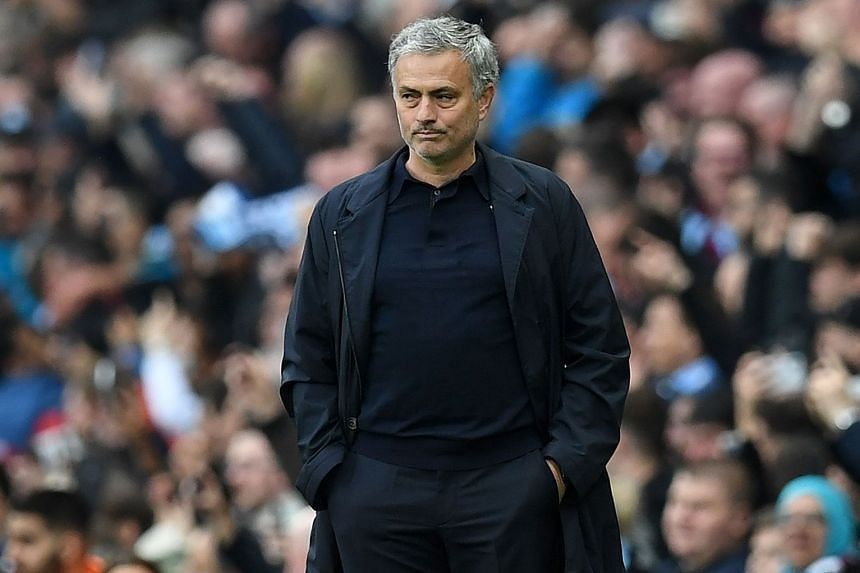 Mourinho watching the derby clash.